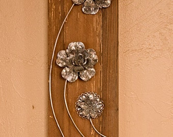 Three flowers on wood