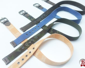 Canvas belts with genuine leather details