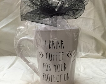 I drink coffee for your protection mug