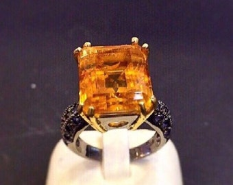Gold citrine ring with amethyst