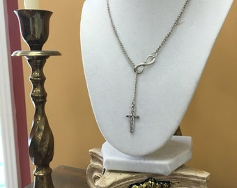 Cross necklace with infinity charm.