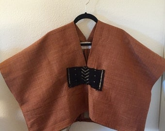 Brick Canvas Poncho Adorned with Hand Woven African Mud Cloth.