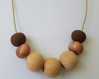 Handmade polymer clay and wooden beaded necklace.