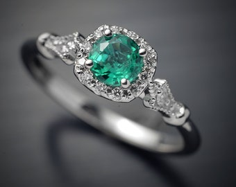 Engagement Ring w/ BEST quality Colombian Emerald and cushion halo and micro pave setting 18kt white gold