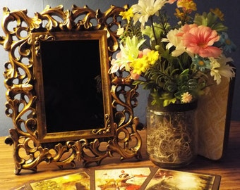 Ornate gold scrying mirror