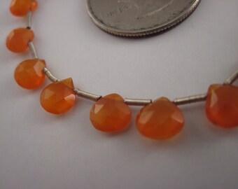 Carnelian briolette 7mm nice bright orange