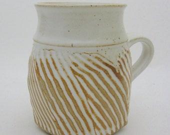 Stoneware mug, wheel-thrown and hand-carved, tapered to keep coffee warmer.