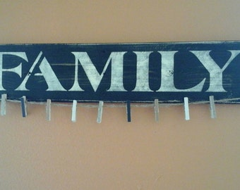 Pallet Family photo display with clothespins .