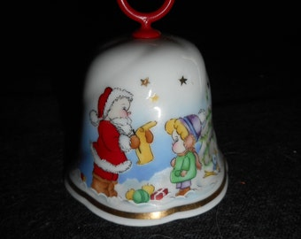 Freiberger porcelain bell made in Germany Picture goes all the way around with Santa and snowman and children