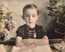 Cute floppy ears kid - original vintage hand coloured photo - portrait of a boy posing with toy animals and book - large photo