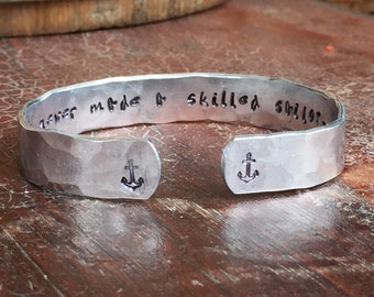 "A smooth sea never made a skilled sailor Anchors Hand Hammered Texture Cuff Bracelet Personalized  Custom Jewelry Hand Stamped 1/2"" Aluminum"