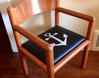 Teak Captains chair with embrodiered anchor.