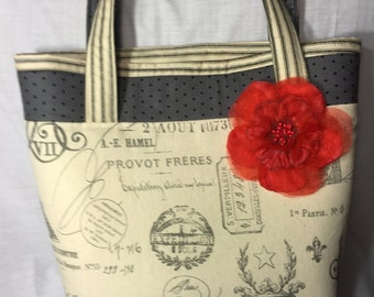 Large sturdy cream and black tote bag with red bow