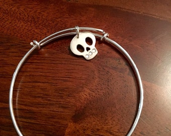 Silver adjustable bangle bracelet with cute skull charm