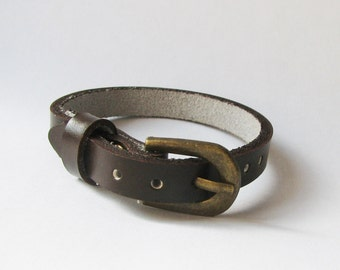 Dark brown leather bracelet watch - belt buckle closure