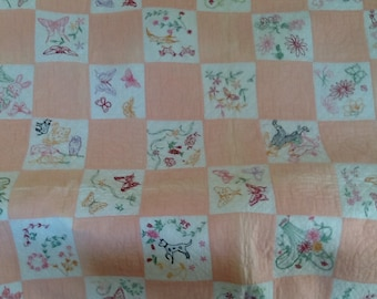 Vintage mid century handmade pink and white quilt, with hand embroidery and hand quilting. Hand embroidered quilt. Hand stitched quilt.
