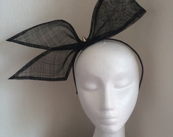 Huge bow black fascinator sinamay  studs Alice band