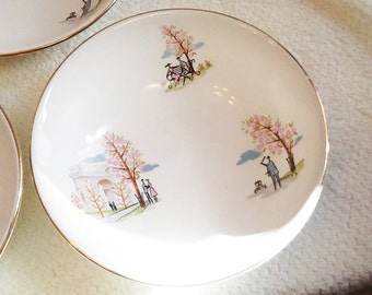 "RARE! SET OF 4 vintage (c. 1950s) Staffordshire Pottery ""Francaise"" pattern cereal bowls featuring French scenes, 22-karat gold rim."