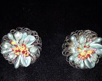Blue muliticolored earrings labeled Western Germany