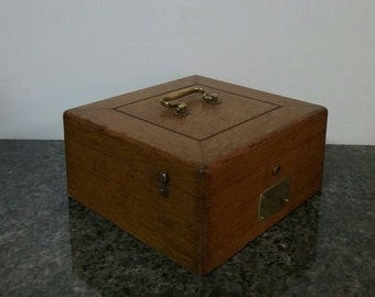Vintage wooden box with nice  brass accents.