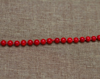 Long beaded dyed red coral necklace