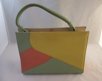 Ladies Vintage Naturalizer Simulated Leather Handbag! Primary Colors are Green and Yellow.