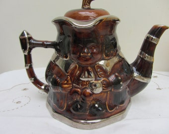 Vintage Price Kensington Staffordshire pottery tea pot. Novelty Toby figure 4 cup teapot. Treacle with silver lustre trim. Superb condition.