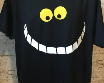 Alice Cheshire Cat grinning face inspired shirt