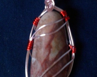 Double Ribbon pendant