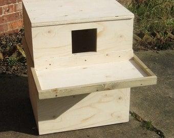 Handmade wooden internal Barn Owl nest box design for use in barns & buildings.