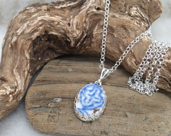 Scottish Sea Pottery and Sterling siver bezel set oval pendant on 22 inch sterling chain .