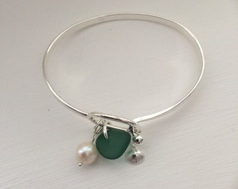 Sea glass , freshwater pearl and sterling silver bangle .