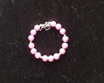 Shocking pink glass pearl bangle