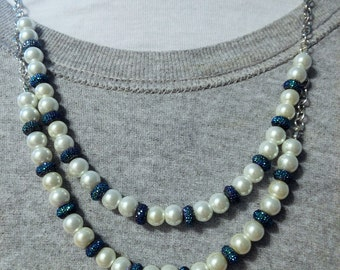 Multi-strand, pearl and blue rhinestone necklace on a silver chain