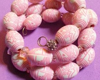 pink and white triple wrap bracelet