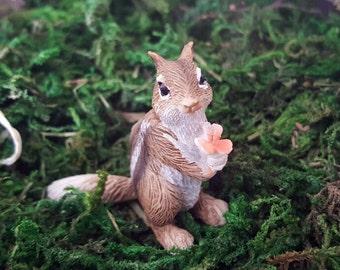 Miniature Chipmunk with a Flower