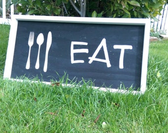 Eat kitchen sign with fork, knife and spoon