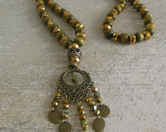 Khaki wooden and gilded glass, sequins, beads and frame beads bronze