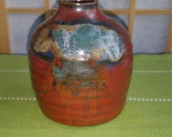 Sake bottle in orange brown