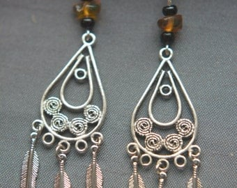 Earrings, beads of amber and feathers metal