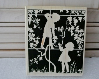 Children playing in tree stamp