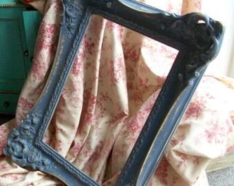 Dark French Grey 'swept' frame.