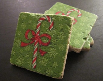 Set of 4 tumbled stone coasters bearing images of a Christmas candy cane. Great for Christmas gift!