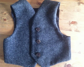 Baby waistcoat in charcoal tweed with stag horn buttons.