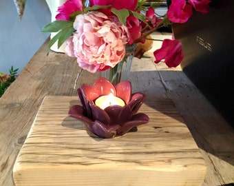 purple flower wooden based candle