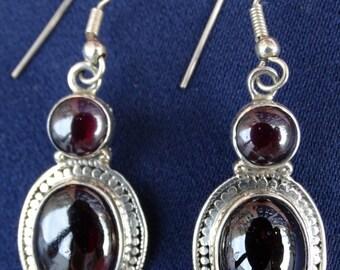 Silver earrings with Garnet stone