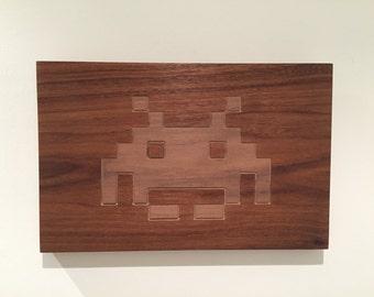 carved walnut space invader