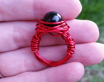 Onyx beaded wire wrapped ring in red wire. 10mm Onyx bead