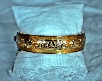 Gold bangle with flower etchings