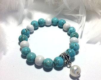 Bracelet turquoise et sa perle blanche